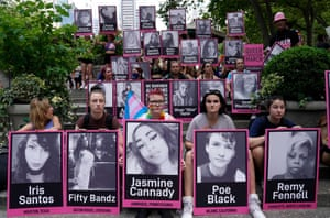 New York, US. People gathered in Bryant Park, holding photos of murdered transgender women and men, during the third annual Queer Liberation march