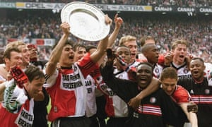 Julio Cruz holds the trophy as the Feyenoord players celebrate winning their 14th title in 1999.