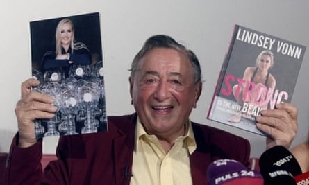 Austrian businessman Richard Lugner presents a photo and a book of former ski star Lindsey Vonn.