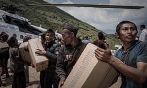 Volunteers unload relief supplies in a remote area after the 2015 earthquake.