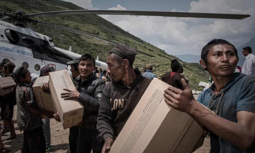 Aid workers and helicopter
