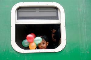 Dhaka, Bangladesh: A child heads home by train to celebrate Eid al-Adha