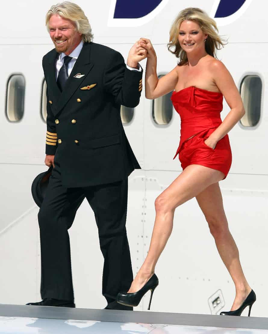 Virgin Atlantic boss Sir Richard Branson poses with model Kate Moss on a wing of a jumbo jet at Heathrow airport, 2009
