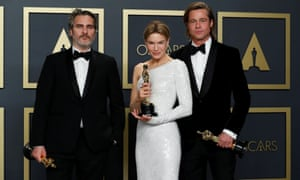 Joaquin Phoenix, Renee Zellweger and Brad Pitt pose with their Oscars at the 92nd Academy Awards.