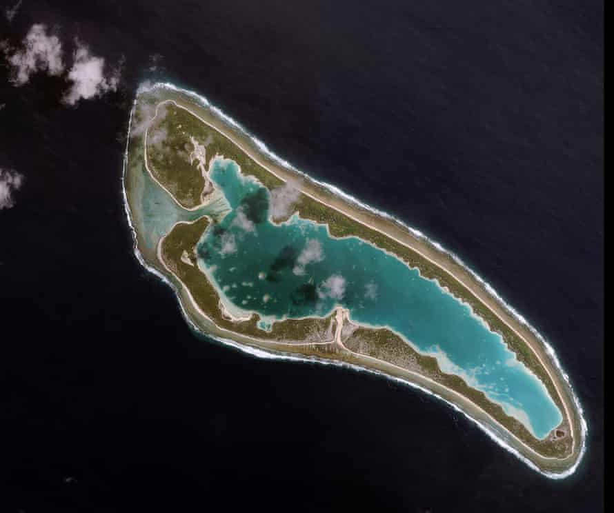 """NIKUMARORO ISLAND ATOLL This four-metre resolution image, collected by Space Imaging's IKONOS satellite on April 16, 2001, shows Nikumaroro Island, an uninhabited Pacific coral atoll in the Republic of Kiribati. The atoll is located about 2,000 miles southwest of Hawaii. Richard Gillespie, executive director of the International Group for Historic Aircraft Recovery (TIGHAR), believes the wreckage of Amelia Earhart's airplane may be found near the atoll. REUTERS/Spaceimaging.com."""""""