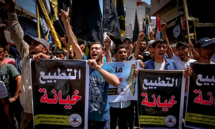 Palestinians hold posters saying 'Normalisation is betrayal' during a protest in Gaza City against a US-brokered deal between Israel and the UAE.