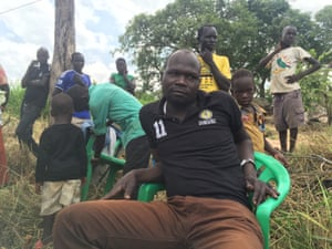 Sam Siyaga, a 34-year-old civil servant from South Sudan, sits in a refugee settlement in northern Uganda