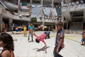 Children play at The Waha Collective Shelter in Lebanon