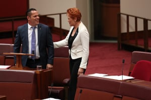 One Nation senator Peter Georgiou talks to the party's leader, Pauline Hanson, before his first speech