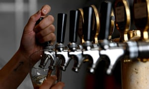 hands pulling a beer in a bar