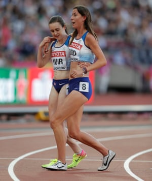 Jess Judd is helped off the track by her team-mate Laura Muir.