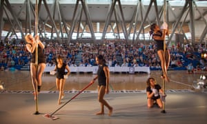 Pole cleaners work hard between each competitors performance.