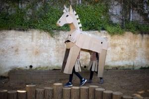 Eliyashiv, Israel. Schoolchildren wear a Trojan horse costume during the Purim parade in the Hefer valley