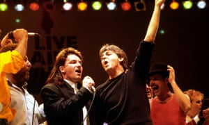 Bono, Paul McCartney and Freddie Mercury, during the finale of the Live Aid Concert at Wembley Stadium, 1985.