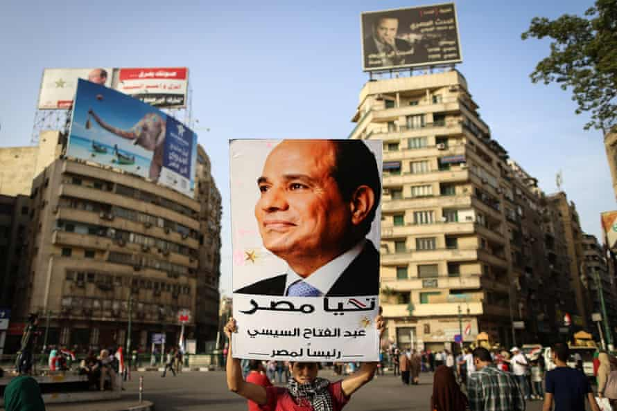 A Sisi supporter holds up a portrait of the president after he won 97% of the votes in the Egypt's 2014 election.
