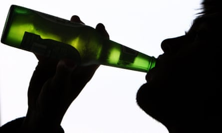 Person drinking bottle of beer