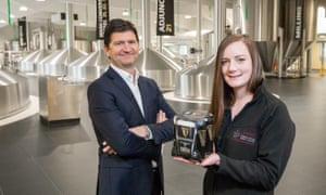 Diageo Ireland's country director, Oliver Loomes, and brewer Orla Gill unveil the plastic-free packaging for Guinness cans.