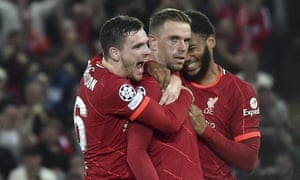 Liverpool's Jordan Henderson (centre) is congratulated by his teammates Joe Gomez (right)  and Andrew Robertson after scoring their third goal.