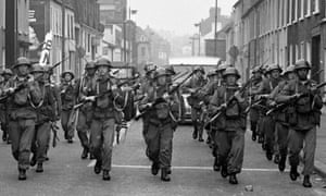 British troops patrol the streets after being deployed to end the Battle of the Bogside, Derry, Northern Ireland, mid to late August 1969.