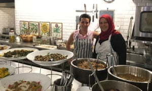 Chef Dima al-Chaar, left, with a co-worker at Tawlet restaurant in Mar Mikhael, Beirut, Lebanon.