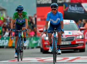 Movistar's Alejandro Valverde and Colombian cyclist Nairo Quintana look despondent as they cross the finish line of stage 20.