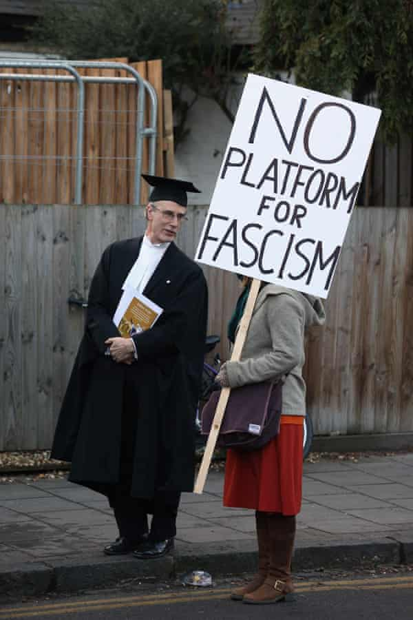 A proctor and a protester on the day Marine Le Pen, the leader of the French Front National party, was to address the Cambridge Union's debating society, 2013.