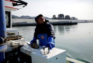 Oyster fisherman Atsushi Fujita