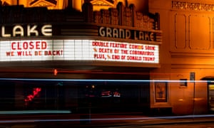 The Grand Lake in Oakland theater displays a message about Donald Trump and the Coronavirus on their marquee