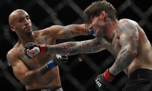 Mike Jackson, left, lands a punch on CM Punk during their welterweight clash at UFC 225