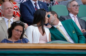 Sergio Garcia, wearing his Masters green jacket, kisses his fiancee Angela Akins as they sit next to William Hague in the Royal Box on Centre Court