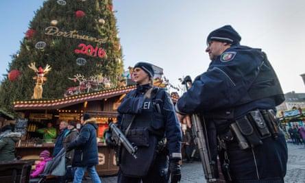 Police officers patrol the Dortmund Christmas market