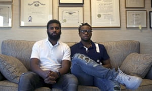 Rashon Nelson, left, and Donte Robinson settled with the city of Philadelphia for a symbolic $1 each and a promise to set up a $200,000 program for young entrepreneurs.