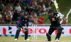 New Zealand's Ross Taylor bats as Jos Buttler looks on.