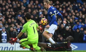 Tom Davies lifts the ball over the Manchester City goalkeeper Claudio Bravo to score Everton's third goal in the Premier League match.