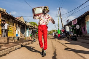 Stephen Okoth, known as Ondivow, is a 25-year-old filmmaker, photographer and model known for his colourful fashion. He has made it his mission to stand out on the streets of his hometown with his signature bright clothes bought from the second-hand markets.