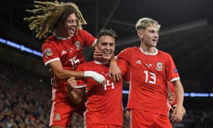 Wales' Connor Roberts (centre) celebrates with teammates Ethan Ampadu (left) and David Brooks.