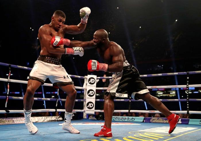 Anthony Joshua beats Carlos Takam by TKO to retain world