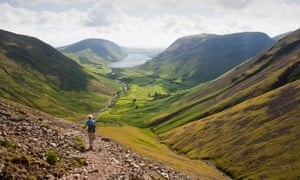 A walker descends Great Gable towards Wasdale in the English Lake District.