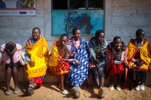 Maasai women wait in line to cast their votes in general elections at a polling station in Iloodokilani