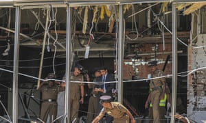 Officials inspect the site of a bombing at the Shangri-La hotel in Colombo
