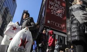 A shopper leaves Macys in New York, New York, on 29 November 2019.