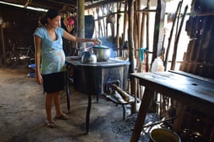 Mirna Leiva, 20, cooking in her house