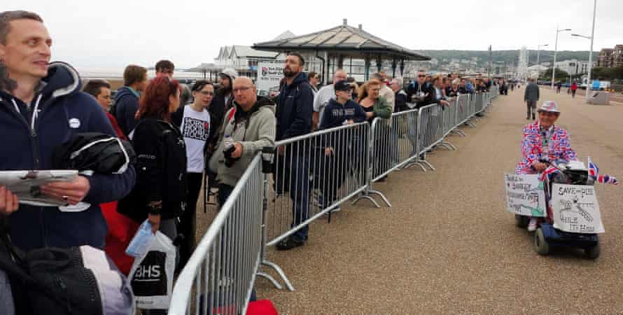 Local residents queue round the pier to be one of the 1,000 people given first look at the Banksy exhibition.