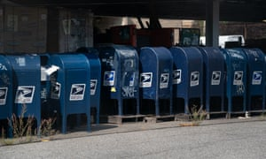 Mail boxes sit in the parking lot of a post office in the Bronx, New York, earlier this month, amid reports that many had been removed from service.