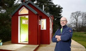 Jonathan Avery with the prototype of the house he designed for the Social Bite village.