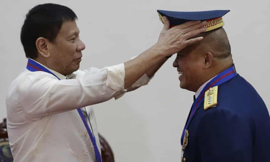 Rodrigo Duterte, shown appointing the Philippines' new police chief, Ronald Dela Rosa, has pledged to take brutal measures against drug traffickers.