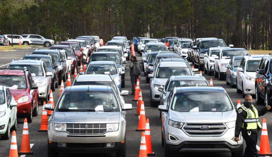 Hundreds of cars line up as people wait to receive a dose of the Pfizer vaccine at a drive-thru vaccination event in Clermont, Florida.