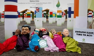 Activists of global anti-poverty charity Oxfam wearing masks depicting some of the world leaders stage a protest outside the venue of the World Climate Change Conference 2015 (COP21) in Le Bourget, near Paris, France