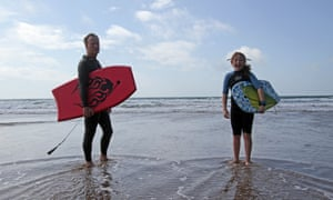 Kevin Rushby and daughter Maddy bodyboarding in Pembrokeshire.