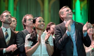 The Swedish Green party candidate Alice Bah Kuhnke, centre, and Per Bolund, minister for financial markets and housing, right, applaud in Stockholm as results come in.